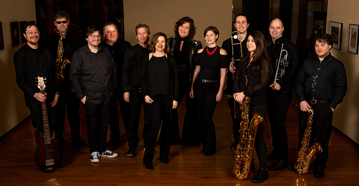 group photo of She Funk, a 12-piece funk band